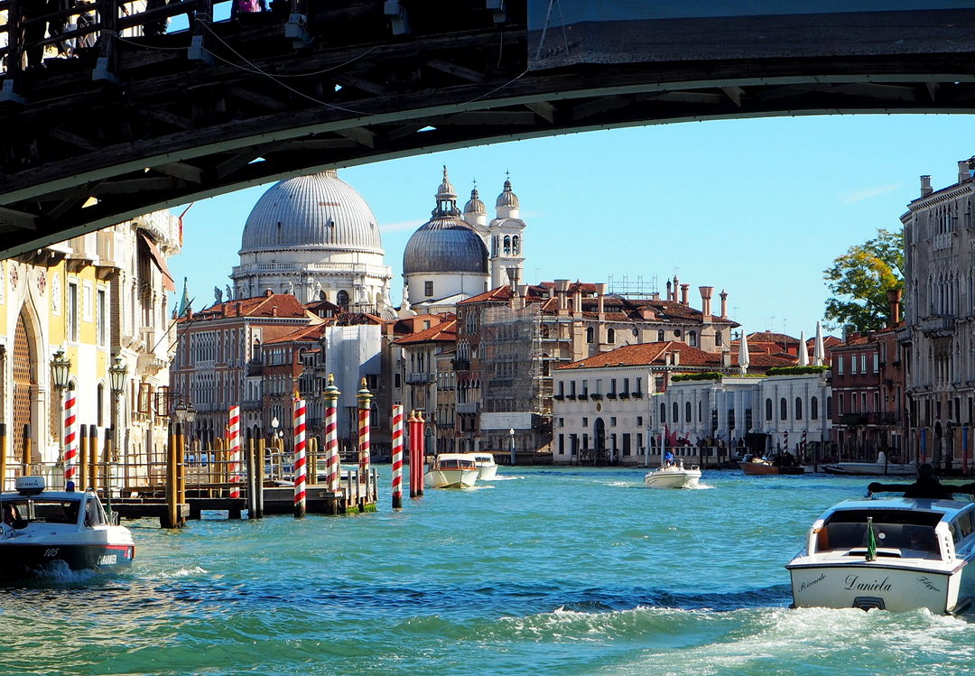 Passing under the Ponte dell'Accademia, the Basilica di Santa Maria della Salute in the background